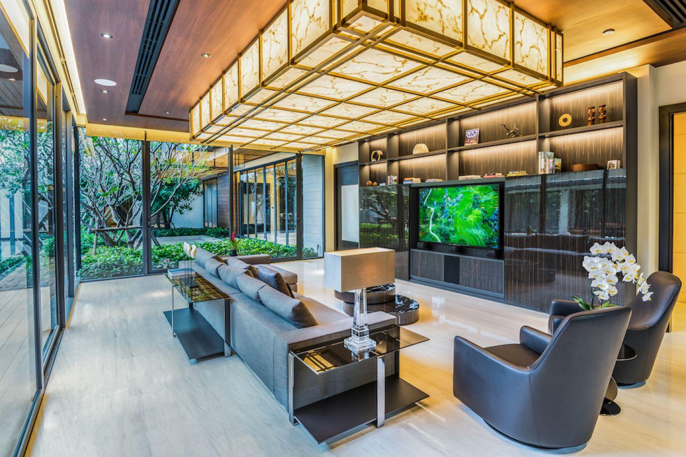 Living room with AV system, TV shown